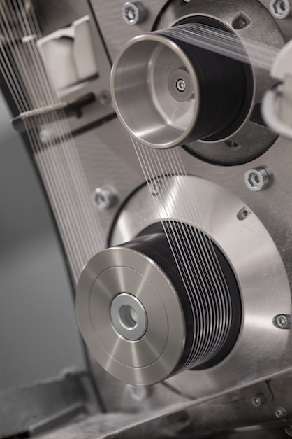 Superbly suited to the efficient production of high-titer yarns: the Oerlikon Barmag concept comprising WINGS HD and eAFK Big V.(c) 2020 Oerlikon