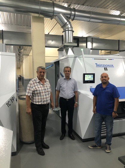"""Cards are the beating heart of the spinning mill,"" says Bülent De?irmencio?lu (pictured in the middle). ""We know we've made the right choice with the TC 19i for man-made fibers because it's taking our superior quality to the next level – while also cutting waste, reducing energy consumption and saving labor costs."" (c) 2020 Truetzschler"