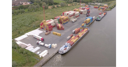 Caption: Sustainable container transport passing through the River Terminal Wielsbeke, B.I.G.'s global inland hub to the rest of the world. (Photo: © POM West-Vlaanderen)
