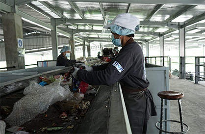 Project STOP workers on a waste sorting line in Jembrana, Indonesia. photo: © Project STOP