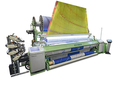 """Optimum transitions from the pile to the border: The terry weaving machines from DORNIER deliver the highest precision and loop quality DORNIER Air-Jet Weaving Machine A1 ServoTerry, Type ATSF 8/J G with a nominal width of 340 cm Artikel: Terry fabrics (Image: """"Terry weaving""""; Source: DORNIER)"""