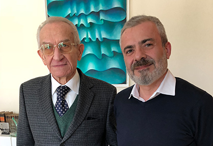 Francesco Ronchi, Managing Director of MASTER, and Enzo Paoli, Managing Director of KARL MAYER ROTAL (on the right)<br /> (c) 2018 KARL MAYER