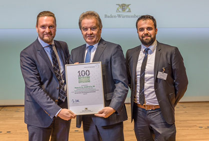 Pic: Franz Untersteller (centre), Baden-Württemberg's Minister for the Environment, Climate Protection and the Energy Sector, presents the award to Marcus Mayer, Managing Director of Mayer & Cie. (left), and Heiko Hämmerle, head of plant technology at Mayer & Cie. Photo credit: Stefan Longin