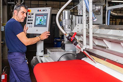 The extremely flexible texCoat unit at Mariani in Italy is allowing the company to carry out both knife over air and knife over roller coating based on simple and user-friendly PLC techniques. (c) 2019 Monforts