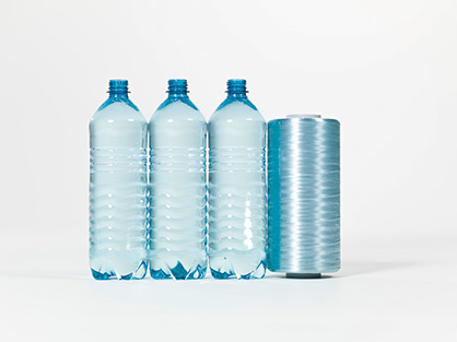 PET bottles are turned into tapes for plastic fabrics (c) 2019 Starlinger