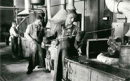 1945: Hardening processes at steel plant in the early days of the association. (c) 2020 Swisstex Textile Machinery