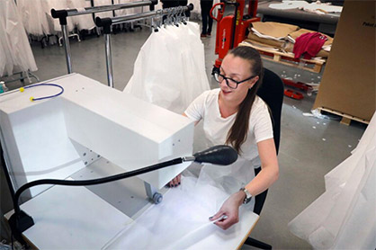 "Jessica Eckerström usually works at ACG Group's Eskil printing plant, which has reduced order intake She is now working on the production of protective garments. ""It great to be able to help, and fun too,"" she says. Image courtesy of BoråsTidning. (c) 2020 TMAS"